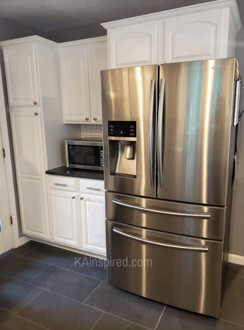 Kitchen remodel with new stainless steel refrigerator